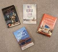 Kärlek och feelgood böcker mot ett beigt golv . Ett frågetecken är ett halvt hjärta, Varmmjölk och I hjärtats bibliotek är tips från personalen.